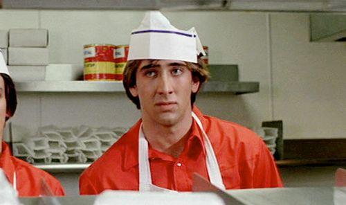 Nicolas Cage flipping burgers